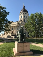 Lincoln in front of the Kansas statehouse