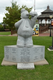 "A statue to Wimpy - ""I will gladly pay you Tuesday for a hamburger today."""