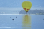 The balloon skimming the surface of the lake