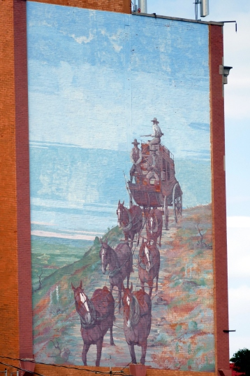 Mural of a stagecoach on the Santa Fe Trail